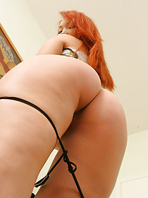 Redheaded Asian chick takes off her colorful get-up to pose naked