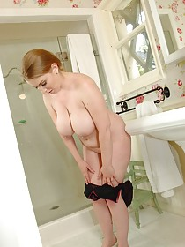 Chubby blonde MILF showing off her pudgy naked body in the shower