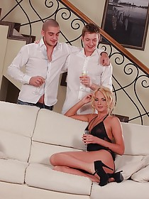 Sensual-looking European blonde gets shared by two hung dudes