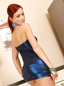 Redhead hottie with long legs takes off her stylish blue dress