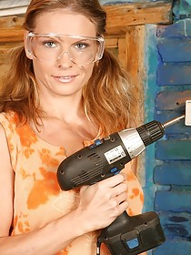 Pigtailed MILF in denim shorts operating power tools and fingering