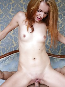 Blue-eyed redhead chokes on this guy's massive cock and gets fucked