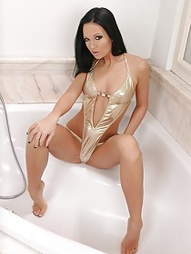 Golden sling bikini brunette enjoying her masturbation in the bathroom