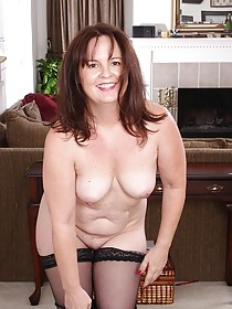 Fat-faced brunette in black stockings showing off her frumpy body